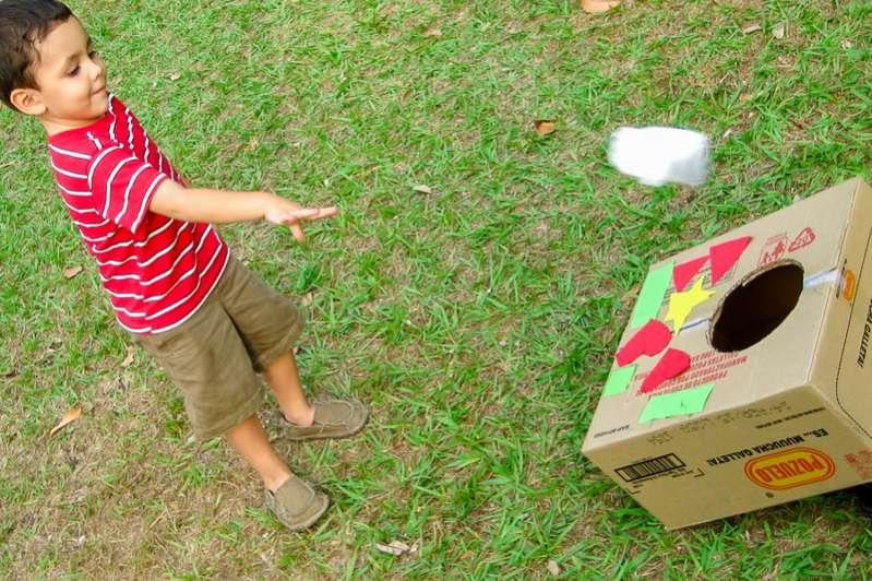 Kids playing cornhole