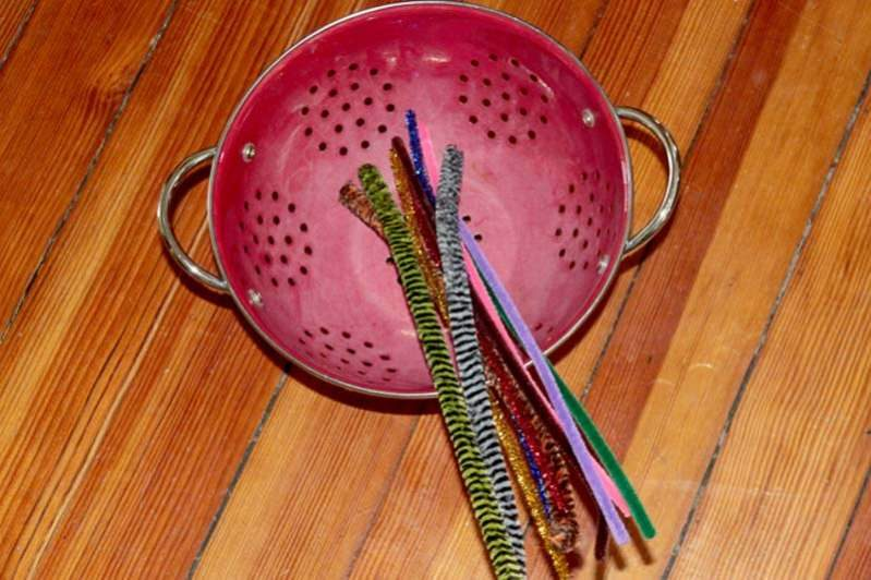 Set out pipe cleaners and a colander for an afternoon of fine motor busy play!