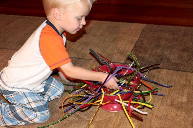 Just pipe cleaners and a colander - such a simple fine motor activity for toddlers to try.