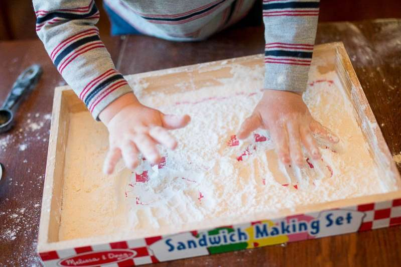 Making handprints is a fun way to play in your flour sensory tray!