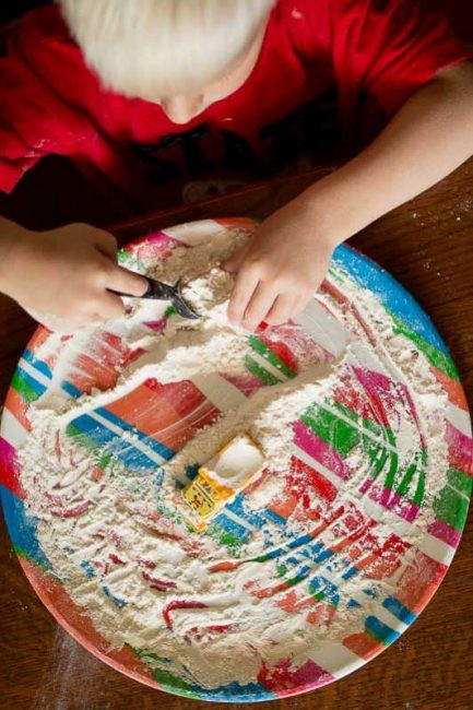 Set up an easy flour sensory play activity to keep kids busy