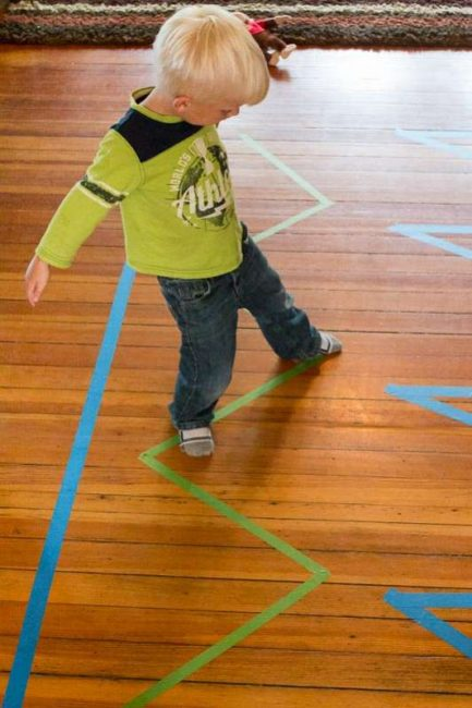 Try to move in different ways as you balance on the lines of colored tape