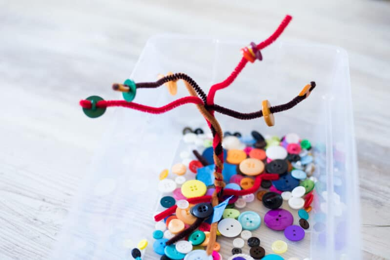 Pipe cleaners and buttons make a fun, gorgeous busy bin for fall!