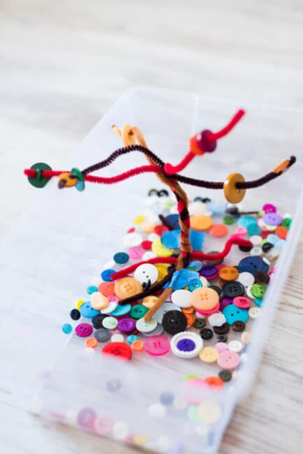 Set up an easy fall button tree busy bin for your kids with a few always-on-hand supplies.