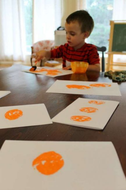 We made cards out of our potato stamping jack-o-lanterns!