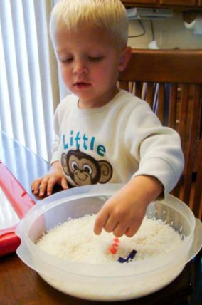 Use a rice sensory bin to find and spell your name