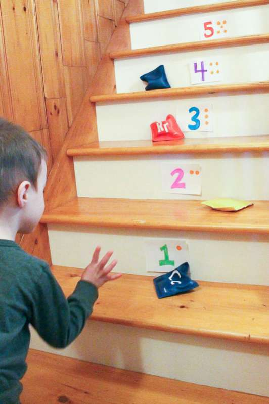 A simple bean bag number toss game on the stairs is a great activity for preschoolers!