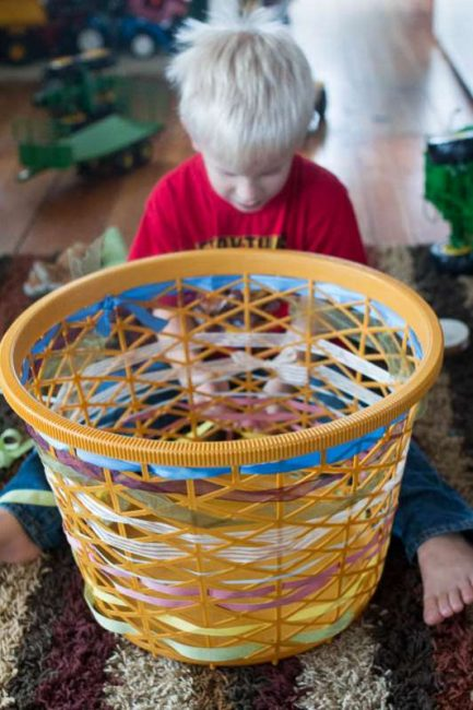 Weaving with ribbon, in and out (a pattern activity)