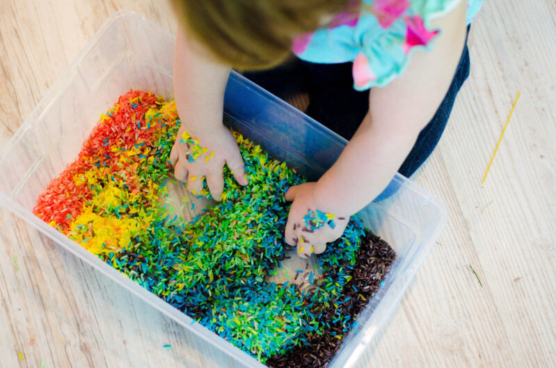 A rainbow rice sensory bin is great for toddlers!