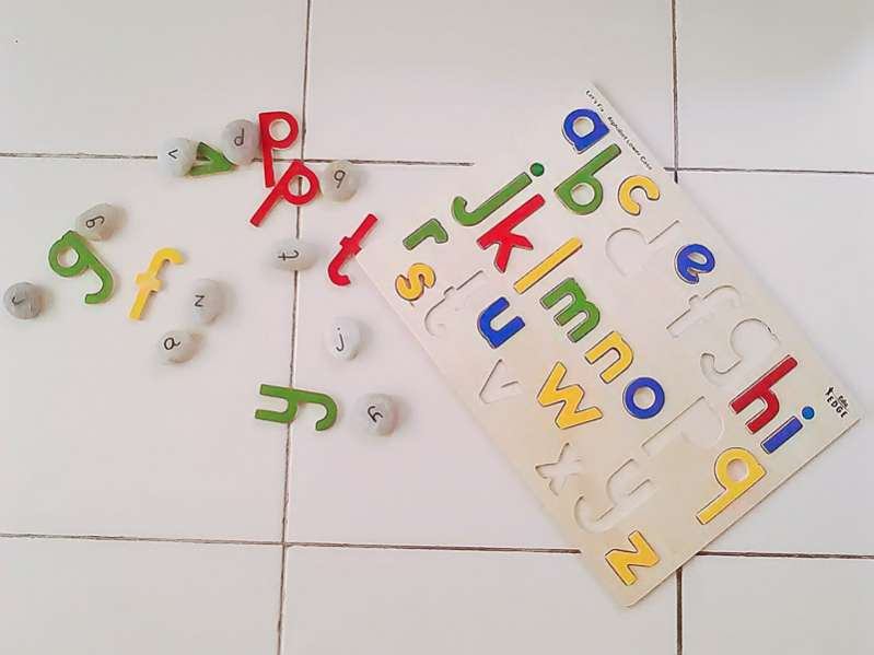 How to learn letters in a rainbow rice sensory bin
