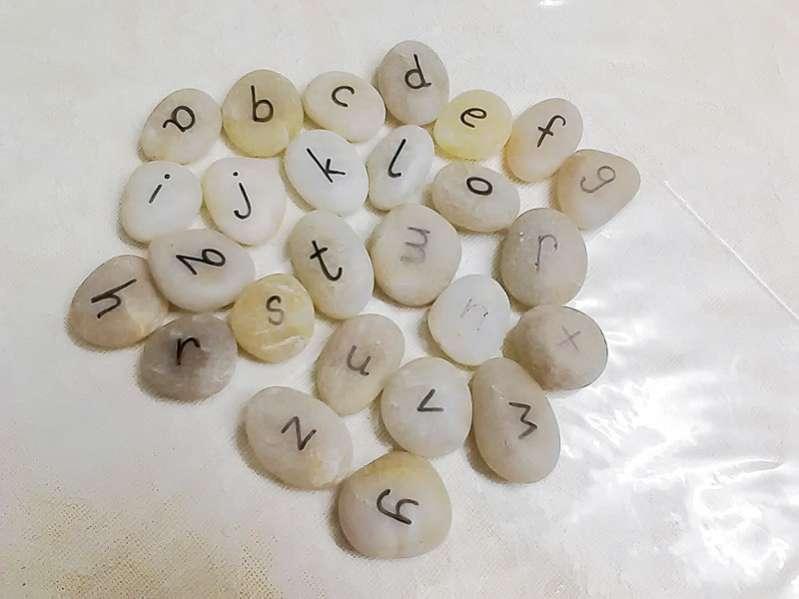 Learning letters in a rainbow rice sensory bin