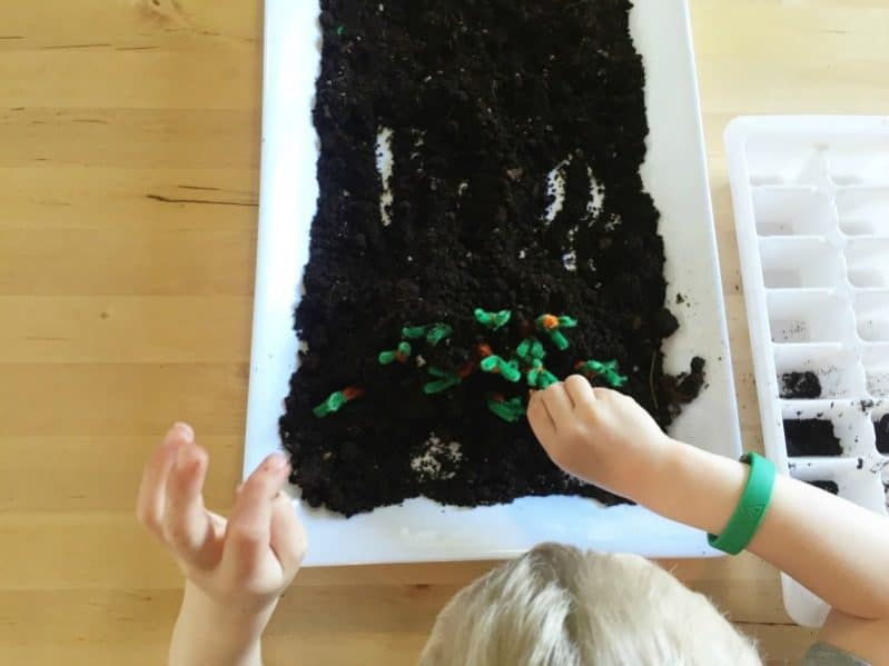 Explore spring with a sensory fine motor garden activity.