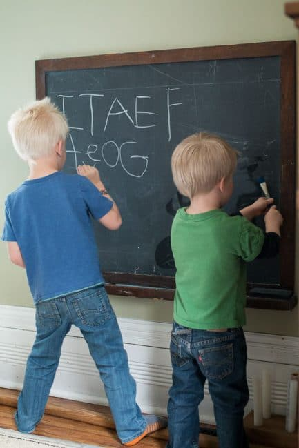 Preschoolers can take lead and write letters on the chalkboard for younger kids to trace and erase away