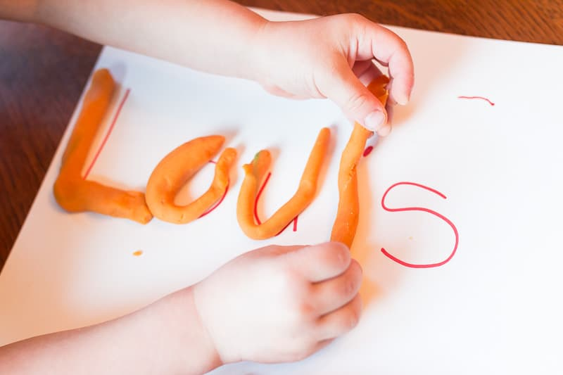 A play dough activity that gets kids strengthening their hands and learning their name.