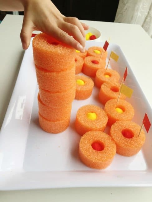 Stack the pool noodle slices to practice building and balancing.