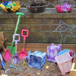 Add loose parts and small toys to your sandbox for creative play!