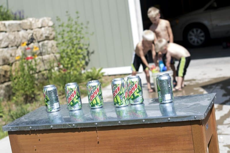 Set up an easy water gun target for the kids to have fun with on a hot day