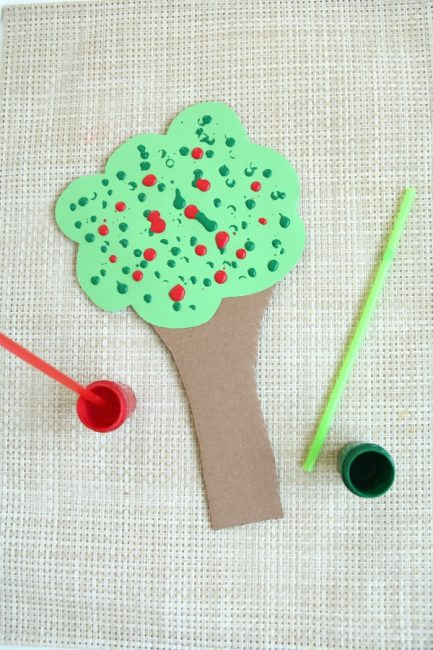 Make a straw drop painting apple tree craft this Fall.