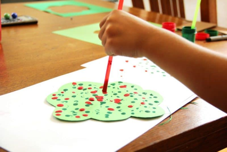 Kids love to create this straw drop painting apple tree craft!
