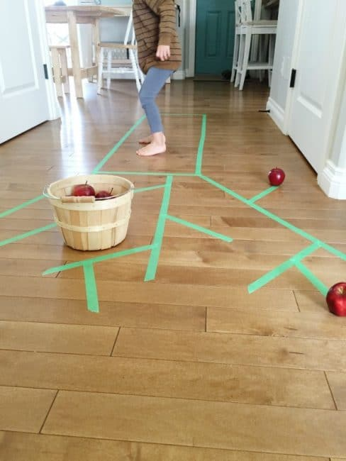 Work on gross motor skills when you go apple picking indoors!