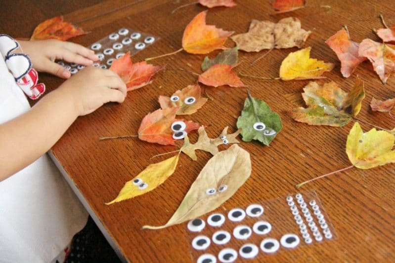 Toddlers will love to make this leaf people fall craft with real leaves.