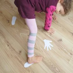 Indoor activity for preschoolers who love to move about. Get your kids active with this paper hands and feet gross motor activity! Great for body awareness, stretching and strengthening muscles.
