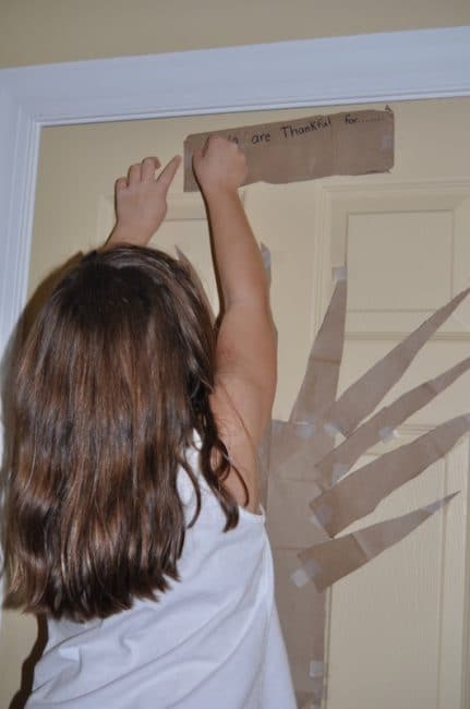 Thanksgiving Thankful Tree. Use on-hand items to make a large holiday art piece and talk about gratitude with your kids.