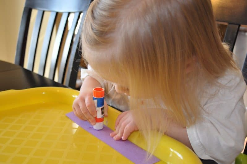 Use simple shapes to build your own menorah Hanukkah craft!