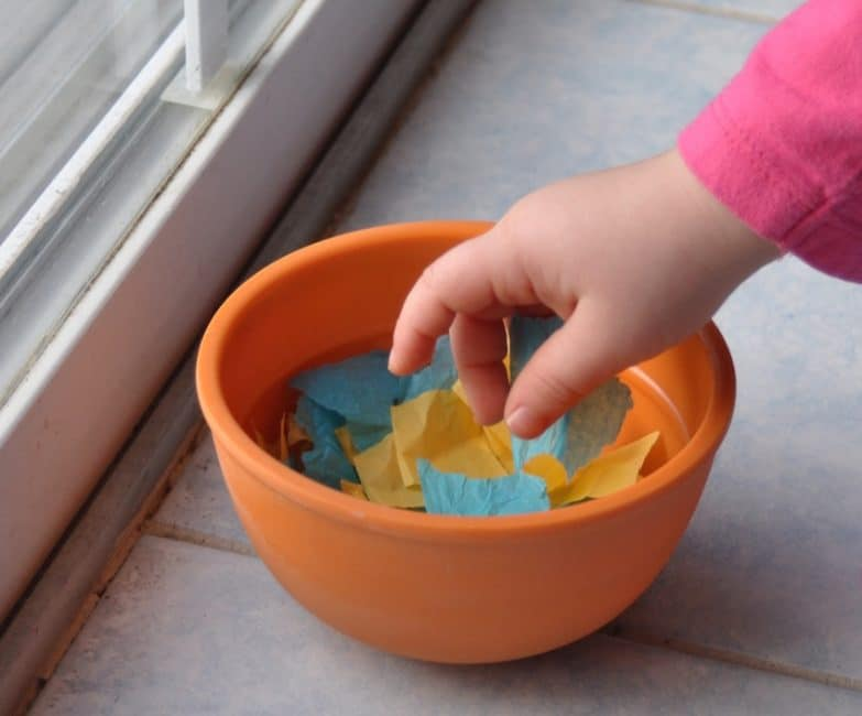 Use tissue paper scraps for this super simple color sorting activity!