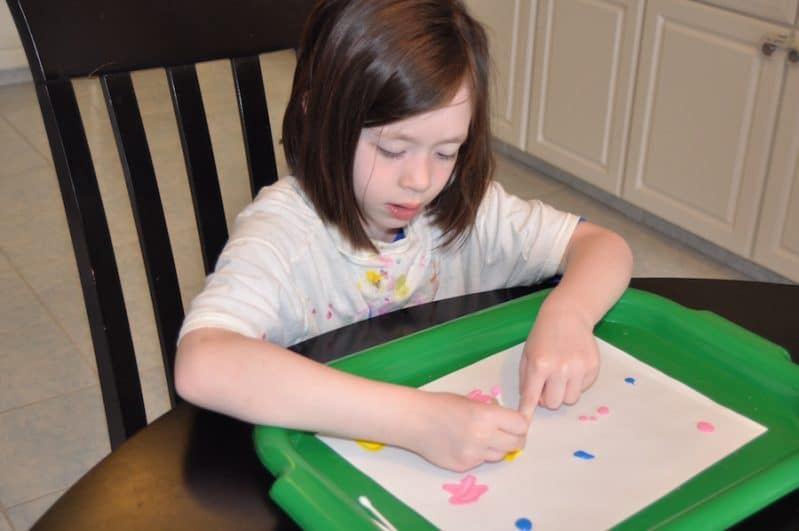 This painting activity is super easy to set up and flexible to fit multiple aged kids.