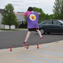Balance beam walking and star jumps are part of a really fun Superhero Playground Challenge!