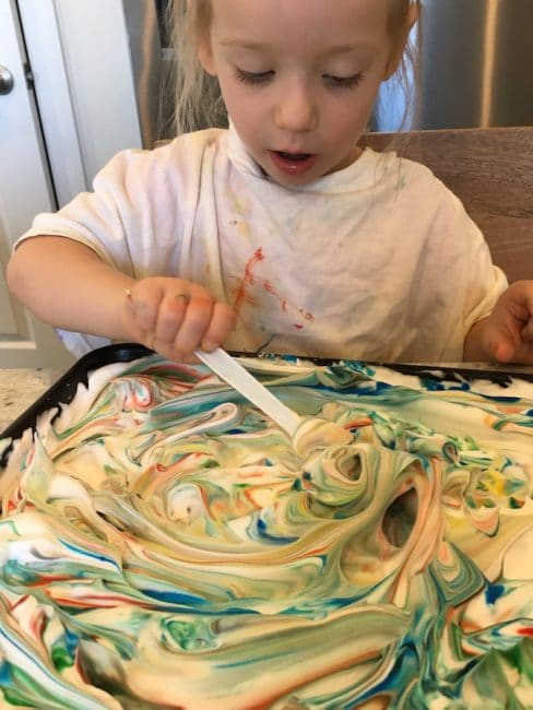 This shaving cream sensory play activity also teaches color mixing.