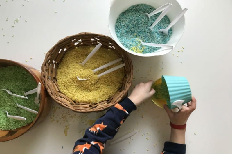 Invite your child to pour, scoop, and play with the rice after the matching is complete