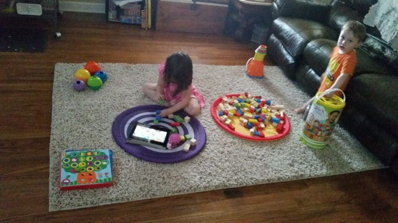 Member of the Month Heather's children discover new toys with her simple corners trick.