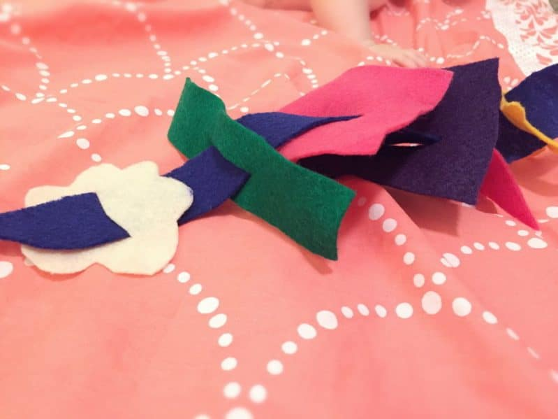 Help your baby explore felt shapes and practice fine motor skills with this easy baby felt play activity.