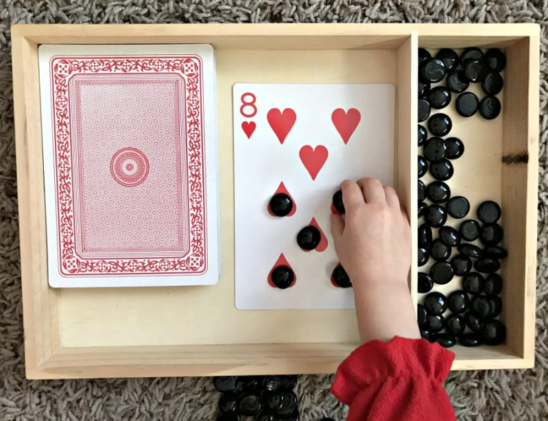 Use jumbo playing cards for extra large fun with this card counting math activity