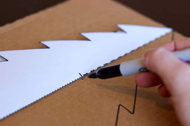 To make your tabletop Christmas tree, trace the printable template onto cardboard.