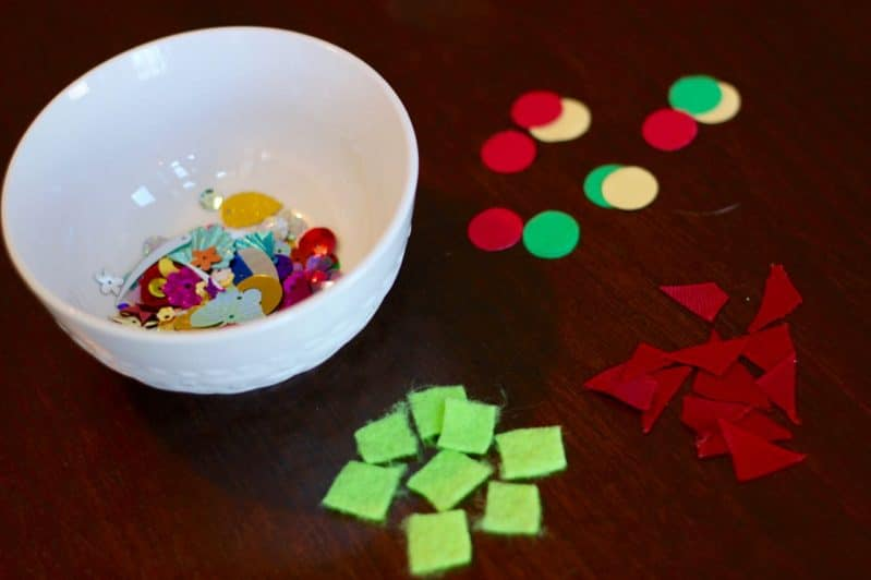 Let your kids help you decorate for Christmas with an easy tabletop Christmas tree activity.