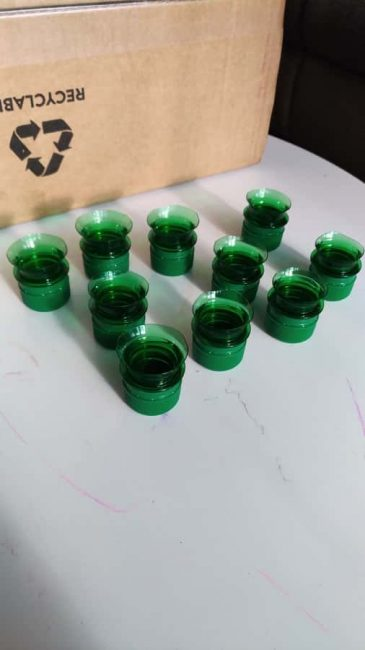 Use bottle tops and caps to build a number matching box