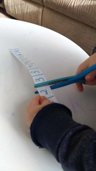 Practice fine motor skills by cutting
