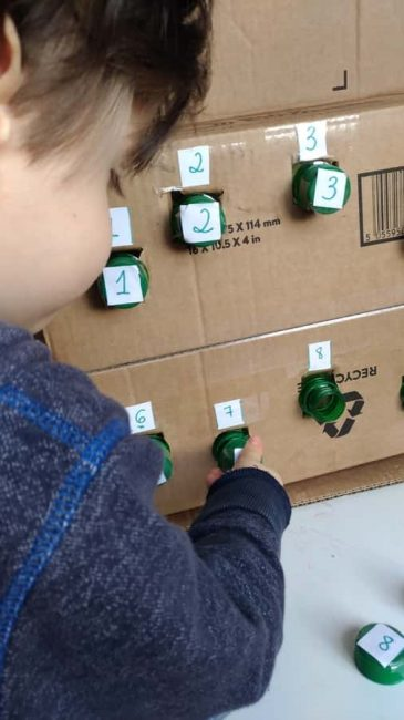 Practice number recognition and fine motor skills with a number matching box