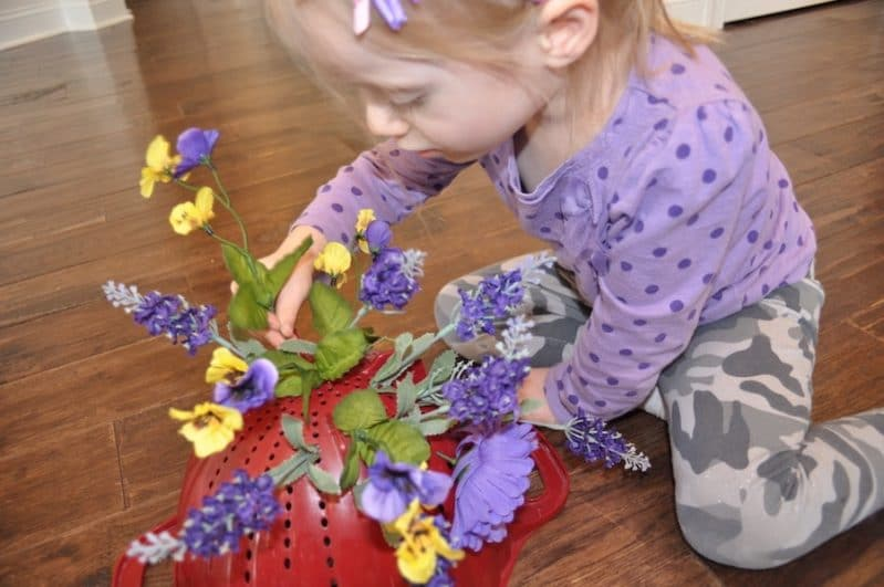 Practice fine motor skills when you add a colander to your spring flower pretend play.
