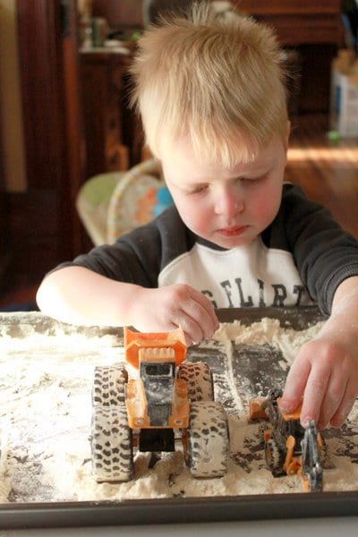 Add trucks and diggers to your flour sensory play activity