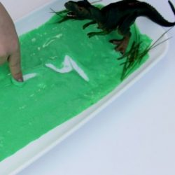 Dive into a dino swamp in a sensory writing activity from The Imagination Tree