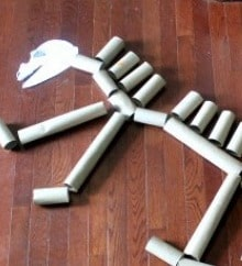 Upcycle toilet paper tubes into a dino skeleton with this activity idea from Your Modern Family