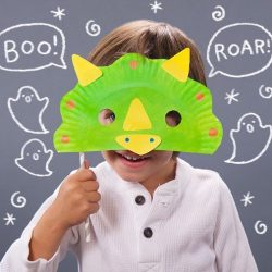 Use a paper plate to make a dinosaur mask from Mom.me
