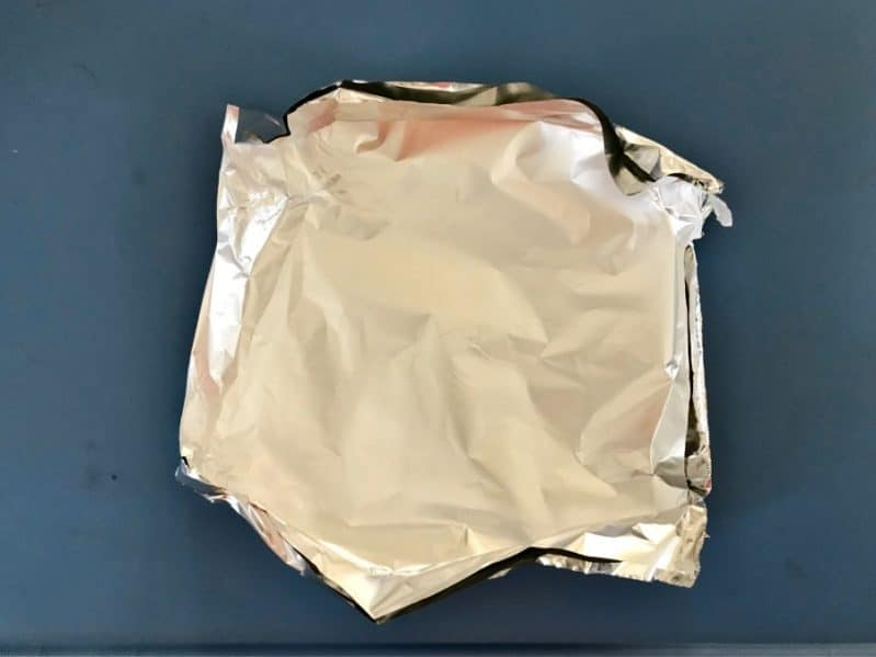 Scrunching aluminum foil for your book based science experiment is a great fine motor skill!
