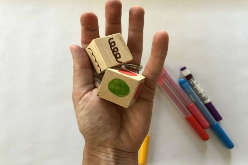 Make DIY Art Dice for a pre-writing art game perfect for preschoolers.