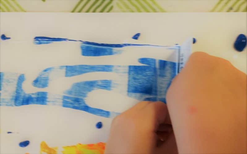 Create a colorful Fall painting with this easy Autumn landscape art tutorial. This scrape painting technique is simple enough for toddlers and preschoolers!
