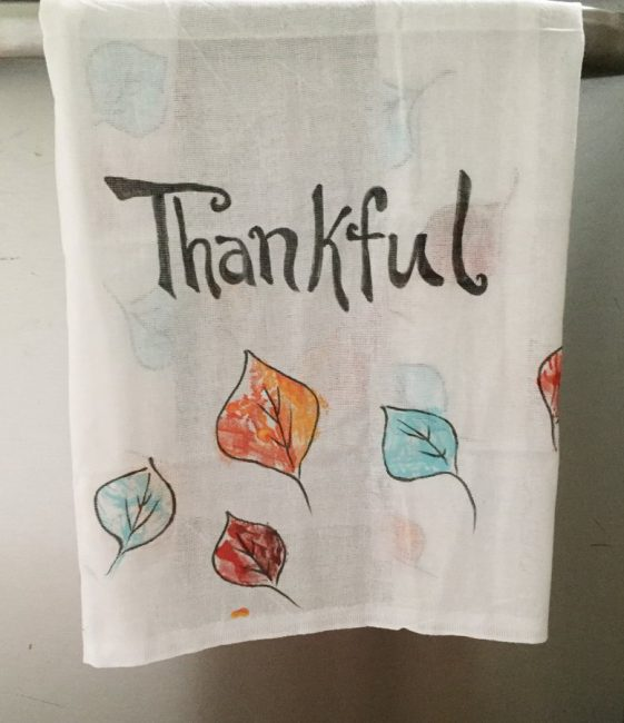 Make a colorful leaf stamped tablecloth! Your kids will love creating their very own tablecloth for Thanksgiving.